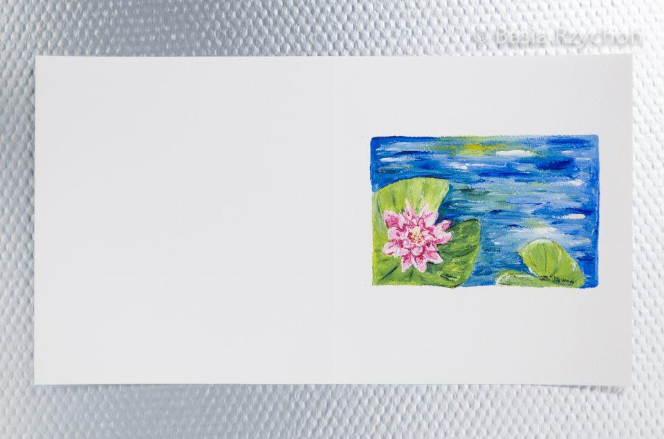 Ręcznie malowana kartka z lilia wodną.